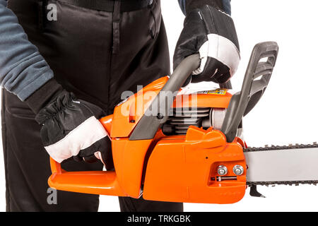 Hands showing how to hold a chainsaw safely - Stock Image