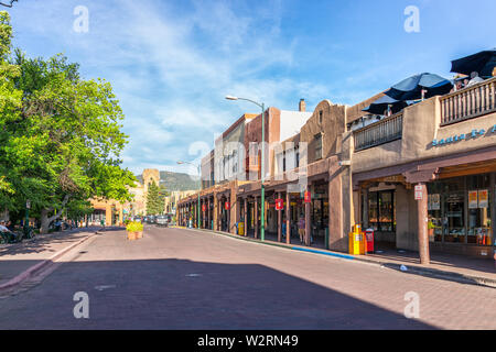 Santa Fe, USA - June 14, 2019: Old town street in United States New Mexico city with adobe style architecture and church - Stock Image