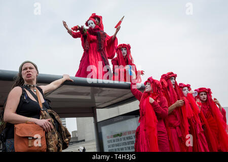 Theatrical Climate Change activists with Extinction Rebellion campaign for a better future for planet Earth after blocking Waterloo Bridge and as part of a multi-location 5-day Easter protest around the capital, on 16th April 2019, in London, England. - Stock Image