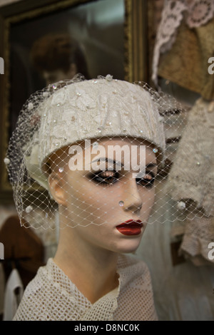 Mannequin head in an antique shop with vintage hat and veil - Stock Image