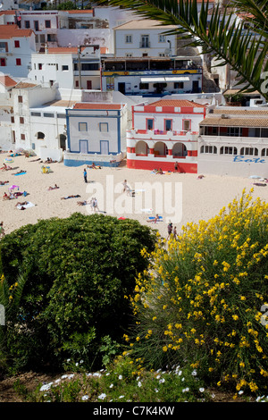 Portugal, Algarve, Carvoeiro, Beach & Colourful Buildings - Stock Image