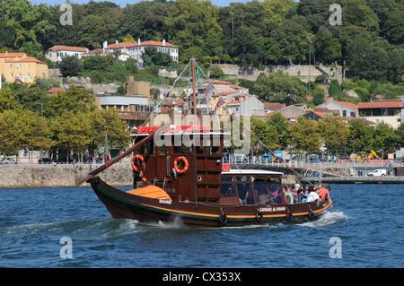 Tourist boat sailing up the River Douro, Oporto, Portugal - Stock Image