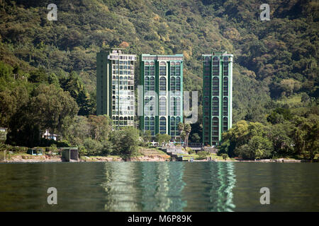 A modern high rise apartment building on the shore of Lake Atitlan makes a perfect holiday (vacation) destination. - Stock Image