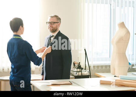 Seamstress and client - Stock Image