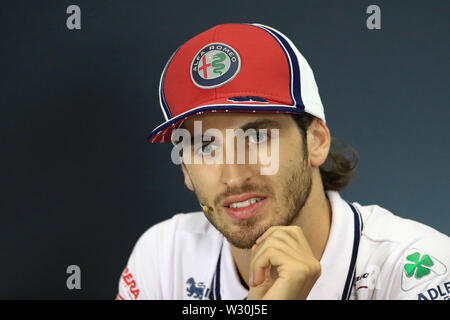 Silverstone, Northampton, UK. 11th July 2019. F1 Grand Prix of Great Britain, Driver arrivals day; Alfa Romeo Racing, Antonio Giovinazzi during driver press conference Credit: Action Plus Sports Images/Alamy Live News - Stock Image