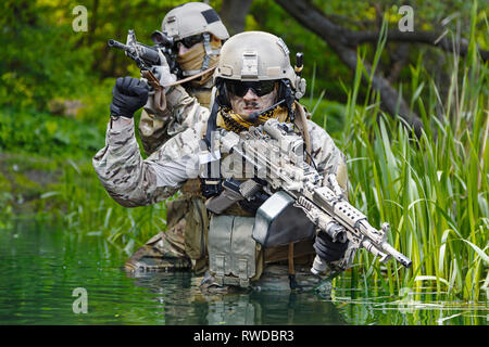 Green Berets U.S. Army Special Forces Group soldiers in action. - Stock Image
