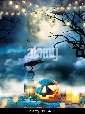 Spooky halloween pumpkin on wooden planks with dark horror background. Celebration theme, copyspace for text. - Stock Image