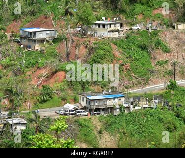 A road and homes near Pezuela have been damaged by Hurricane Maria November 2, 2017 in Lares, Puerto Rico.     (photo - Stock Image