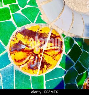 Barcelona, Spain, October 2018. Ceramic mosaic detail by Antoni Gaudi at Park Guell. - Stock Image