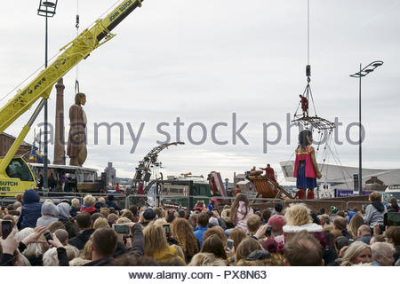 Two Giants are lifted in the air during the finale of the Giants Spectacular parade through Liverpool city centre UK - Stock Image