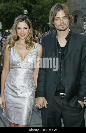 Actress Mira Sorvino and her husband, actor Christopher Backus, arrive for the world premiere of her film 'Reservation - Stock Image