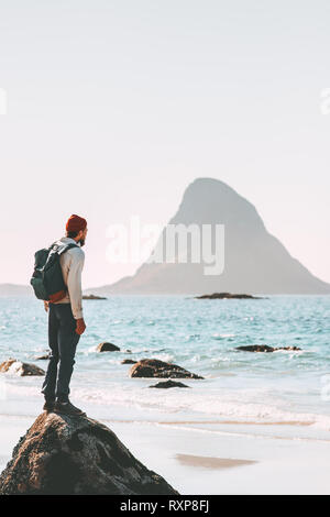 Man wandering alone enjoying sea view on beach travel in Norway active vacations outdoor lifestyle adventure trip escape solitude emotions - Stock Image