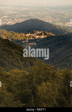 Sunset light over the town of Favaro,  Biella in the Piedmont region of Italy at the foot of Oropa famous location for it's Sanctuary - Stock Image