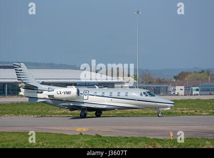 Mid sized business Twin Engined Jet Aircraft preparing to depart Inverness Airport i the Scottish Highlands. - Stock Image