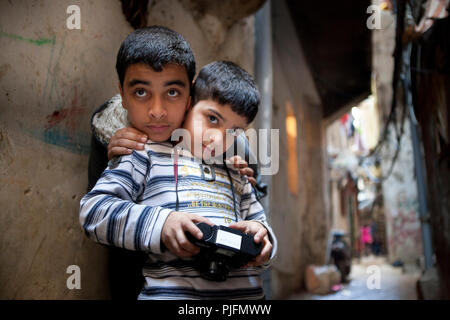 Palestinian children taking photos inside the project Correspondences which put during one year in link a 1st year of primary school of the school Saint Joseph of Lyon and the children going to remedial classes course dispensed by the association Beit Atf - Stock Image