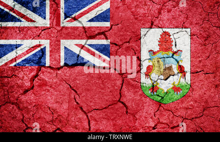 Bermuda flag on dry earth ground texture background - Stock Image