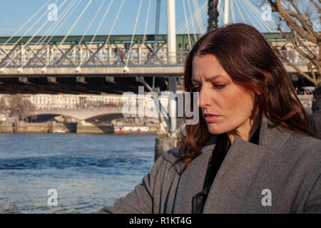 An attractive woman on the South Bank in London - Stock Image