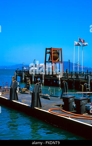 Pier on San Francisco Bay with Alcatraz Island in the background - Stock Image