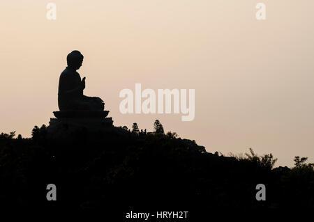 HONG KONG - MARCH 23, 2014 - Silhouette of Hong Kong's famous Big Buddha at Ngong Ping, Lantau Island - Stock Image