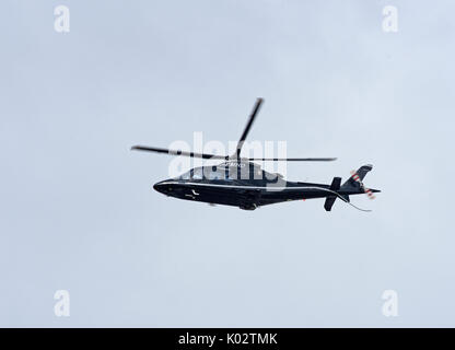 Aircraft departing following a shot stopover at Inverness Airport in the Scottish Highlands. - Stock Image