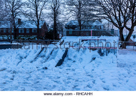 Fleet, Hampshire, UK. 2nd Feb, 2019. Heavy overnight snow followed by a sharp frost made for a difficult early morning for pedestrians and motorists. Image: the skateboard park resembled a ski-jump. Credit: Images by Russell/Alamy Live News - Stock Image