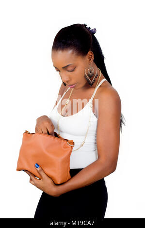 portrait of young woman with her head bowed and rummaging through her wallet. - Stock Image