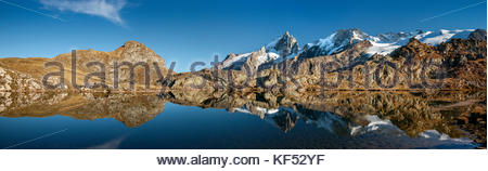Lake Lérié, on the Emparis Plateau, reflecting La Meije north face (France) - Stock Image