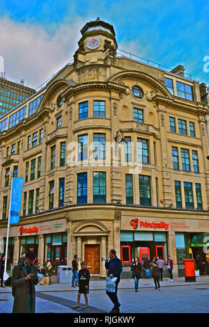 The Principality is a Welsh Building Society with it's head office in Queen Street in Cardiff City Centre. People passing by this historic building. - Stock Image