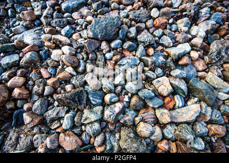 A poster showing the beautiful coloured rocks on the shores of Loch Linnhe in the Highlands of Scotland. - Stock Image