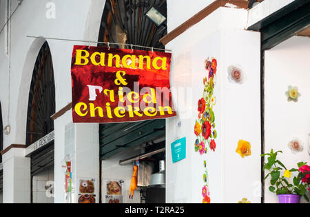 The Banana and Fried Chicken food stand in the Feria Market in Seville - Stock Image