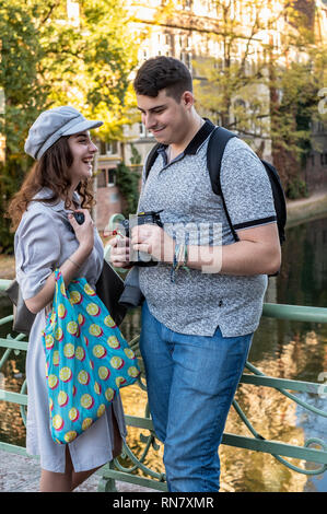 Strasbourg, Alsace, France, young couple of tourists having fun with pictures at their digital camera, - Stock Image
