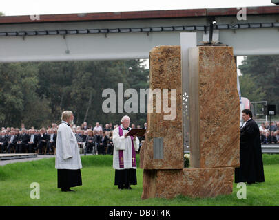 Priests Gerhard Ortmann (L), Rainer Jenke (C) and Winfried Zimmermann (R) hold a oecumenical service in Lathen, - Stock Image