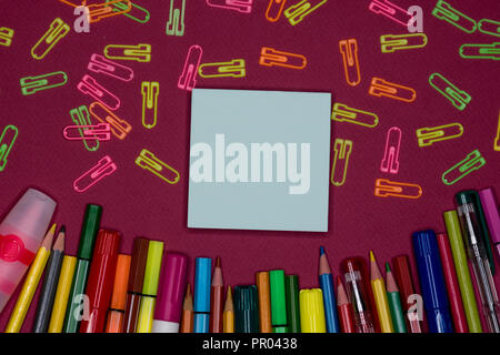 Top view of school accessories on a desk with copy space. Sticky note with text space - Stock Image