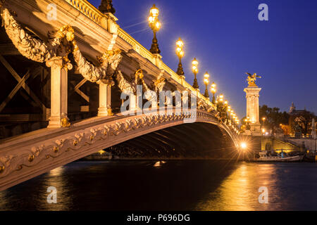 Pont Alexandre III bridge and Seine River at twilight. 8th Arrondissement, Paris, France - Stock Image