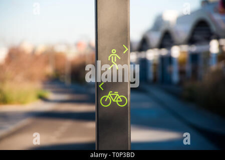 Direction sign for pedestrians and cyclists in city public park lane - Stock Image