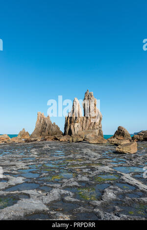 Hashi gui iwa rock.  A straight line of large and small rocks which stretches for around 850 meters In Kushimoto Japan.  One legend says that the monk - Stock Image