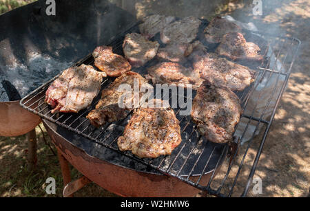 Crete, Greece. Jnue 2019. Pork chops cooking on a barbeque. - Stock Image