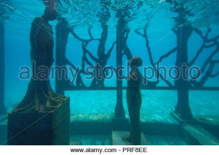 Underwater statues of the Coralarium in Maldives - Stock Image