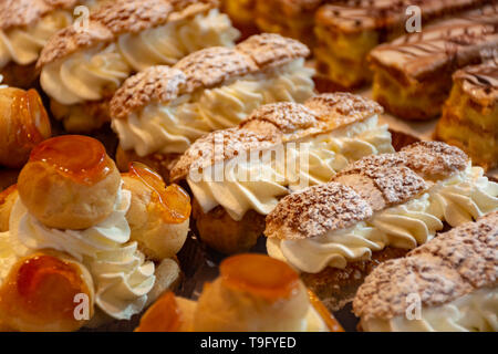 Freshly baked stuffed sweet pastries Orange Lactee and Dome Citron with fruits in traditinal French bakery in small village in Provence close up - Stock Image