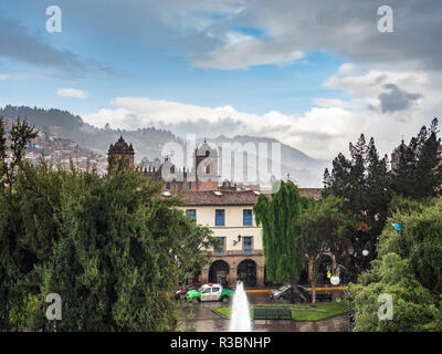 View of the Regocijo square and the Cusco cathedral, Peru, in a rainy day - Stock Image