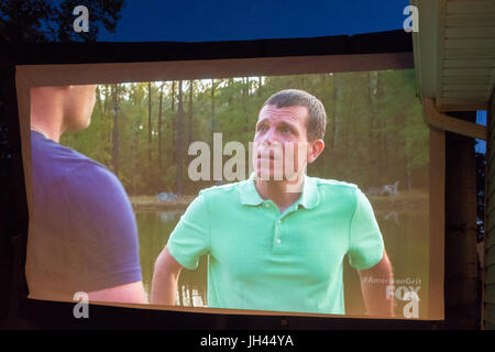 Merrick, New York, USA. 11th June 2017.  On large TV screen, 'American Grit' TV show contestant CHRIS EDOM - Stock Image