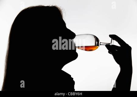 Worker tasting whisky in distillery - Stock Image