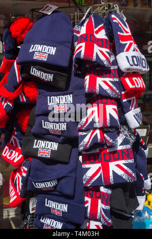 Colourful souvenir hats on sale in London - Stock Image