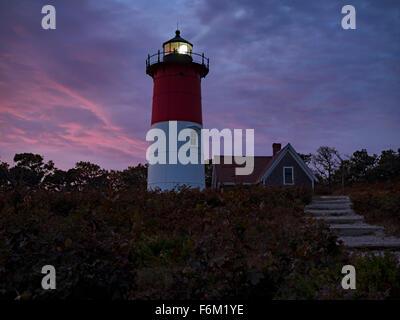 Nauset Light, a landmark red and white lighthouse at Nauset Light Beach in Eastham MA on Cape Cod Massachusetts - Stock Image