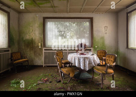 Interior view of a dining room in an abandoned hotel in Germany. - Stock Image