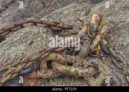 Old and rusty mooring chains. Metaphor strong links, strongest link, forge links, close ties. - Stock Image