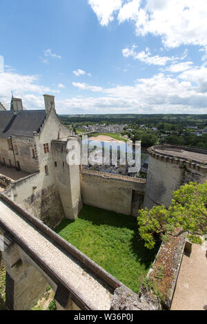 Chinon, France. Picturesque view of the Fortress Royal with the Royal Lodgings in the foreground. The River Vienne and the village of Le Faubourg Sain - Stock Image