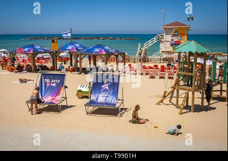 TEL AVIV, ISRAEL. May 11, 2019. Tel Aviv seaside promenade and beach before the Eurovision song contest 2019. Huge beach chairs with the Eurovision - Stock Image