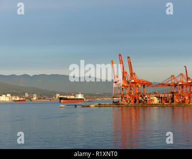 Gantry cranes and container ships in Burrard Inlet, Port of Vancouver, BC, Canada - Stock Image