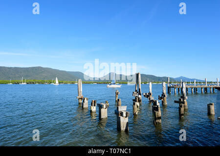 Pillars of the old derelict wharf along Trinity Inlet, Cairns, Far North Queensland, FNQ, QLD, Australia - Stock Image
